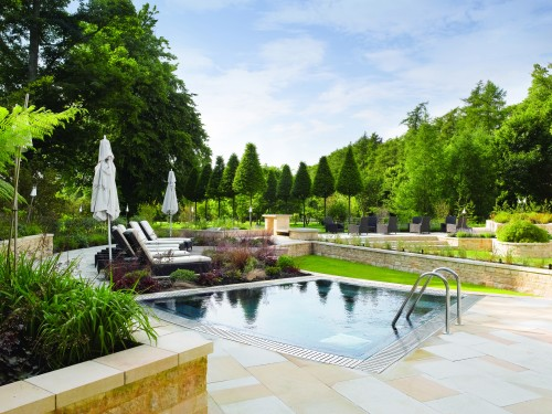 The outdoor pool and relaxing area at the spa at Lucknam Park