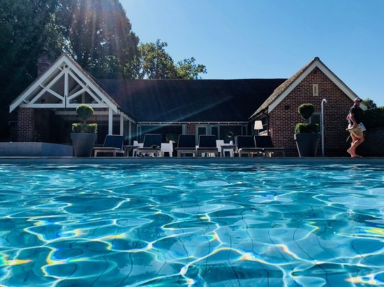 The outdoor swimming pool and pool house at Maison Talbooth hotel in Essex