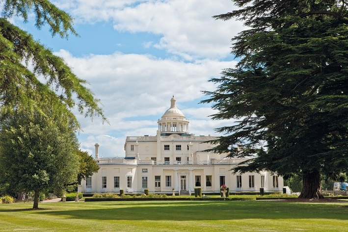stay at Stoke Park luxury hotel view from tennis courts