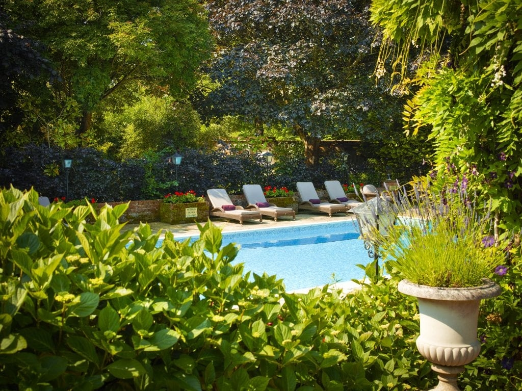 Chewton Glen loungers beautiful hotels with pools for the summer