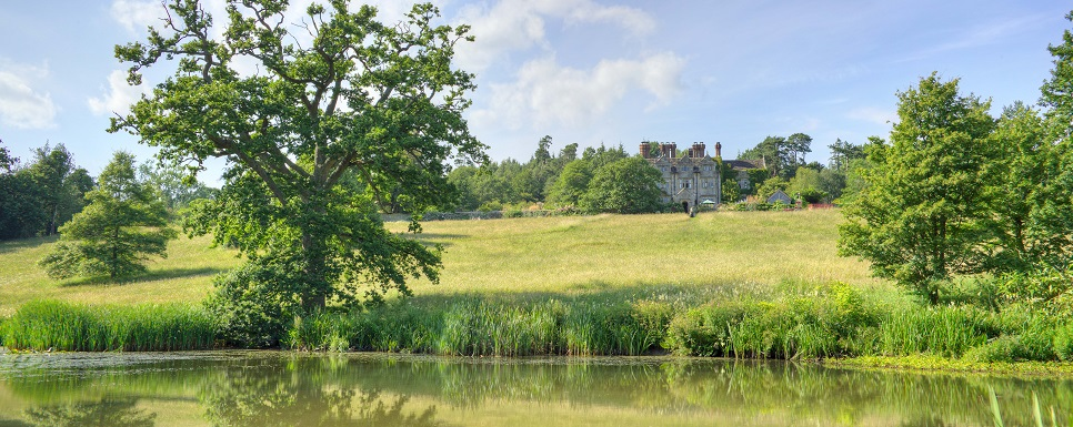 best hotels in west sussex gravetye manor afternoon view from lake